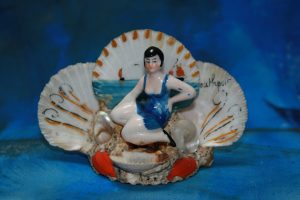 Southport - ceramic figure on painted shell