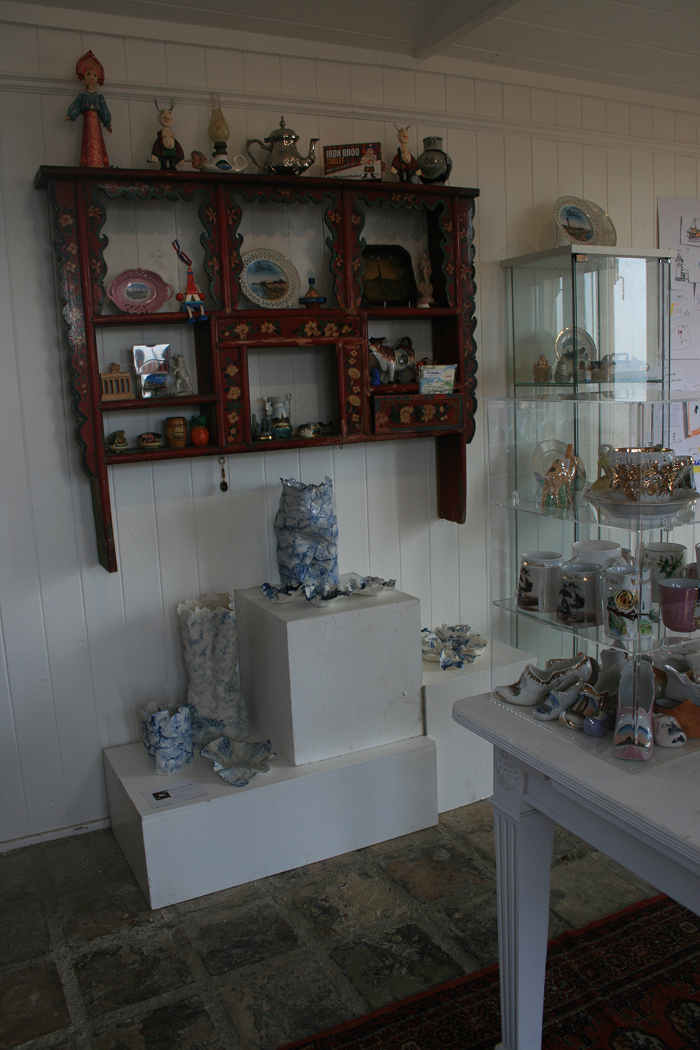 The artwork - made up of souvenirs from the collections of Eileen Haring Woods and Deborah Jaffé alongside the Shoreline ceramics made by Deborah.